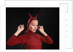 1960s Woman Red Devil Costume With Horns Arms Up In Air Looking Seductively At Camera by Corbis