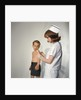 1960s Woman Nurse Give Injection Needle To Little Boy Arm Vaccine Vaccination Prevention Immunize Inoculate Medicine by Corbis