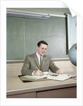 1960s Student Studying Desk Globe Open Book Writing Chalkboard High School by Corbis