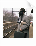 1970s 1960s Man Commuter Waiting For Train Wearing Gas Mask Pollution by Corbis