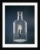 1960s Slumped Over Alcoholic Man Holding Whiskey Bottle Trapped Inside Glass Alcohol Decanter Bottle by Corbis