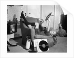 1950s 1960s Teenage Girl Smiling Reclining Upside Down On Chair Holding Vinyl Record Album Listening To Music by Corbis