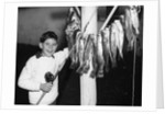 1950s Smiling Boy Proudly Displaying His Fish Catch Looking At Camera by Corbis