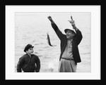 1950s 1960s Boy Son Fishing With Man Father Or Grandfather Holding Up Caught Fish On Line Laughing Having Fun by Corbis
