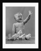1950s Laughing Waving Baby Surrounded By Little Baby Chicks by Corbis
