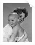 1960s Thoughtful Pensive Mother Holding Happy Baby Child by Corbis