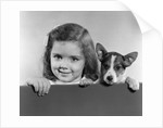 1940s 1950s Portrait Of Little Girl With Small Dog Looking At Camera by Corbis