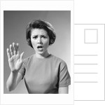1960s Alarmed Woman Holding Up Her Hand To Stop Something by Corbis