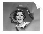 1960s 1970s Portrait Of Smiling Woman Looking Through A Hole Torn In Paper by Corbis