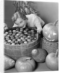 1950s Smiling Woman Leaning Over Wooden Tub Filled With Water About To Begin Bobbing For Apples by Corbis