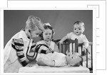 1950s Boy And Girl Playing Doctor And Nurse With Stethoscope And Dolls by Corbis