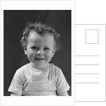1940s Curly Haired Little Boy Portrait Smiling Looking At Camera by Corbis