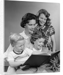 1950s Portrait Mother Two Daughters And Son Reading Book Together by Corbis