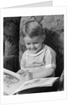 1930s 1940s Little Boy Sitting On Chair Reading Picture Book by Corbis