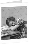 1930s Teenage Girl Sleeping Head Resting On Table Desk While Studying by Corbis