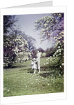 1940s Woman Mother Girl Daughter Walking Spring Landscape by Corbis