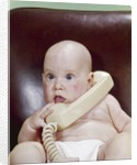 1960s Chubby Baby Sitting In Leather Office Chair Talking On Telephone by Corbis