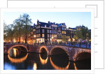 Amsterdam canals at dusk by Corbis