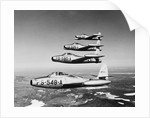1950s four US air force F-84 thunder jet fighter bomber airplanes in flight by Corbis
