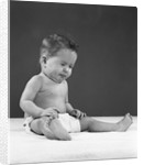 1950s baby wearing diaper and making a funny face by Corbis