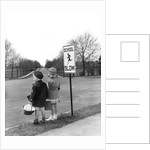 1930s 1940s boy and girl waiting to cross the road by Corbis