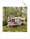 1970s family having picnic by camper by Corbis