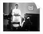 1930s 1940s dentist speaking with a female patient by Corbis
