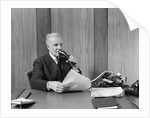 1930s senior executive speaking into a dictaphone by Corbis