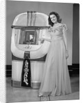 1940s smiling woman with a jukebox by Corbis