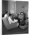 1950s family watching television by Corbis