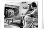 1950s couple watching television by Corbis