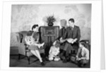 1930s 1940s family of five listening to the radio by Corbis