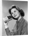 1960s smiling teenage girl listening to portable radio by Corbis