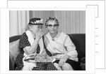 1960s two senior women gossiping by Corbis