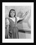 1960s school girl pointing to map of the USA by Corbis