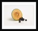 Cantaloupe and berries by Corbis