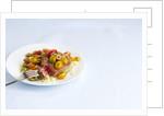 Tuna steak with tomato salad by Corbis