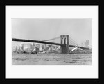 The Brooklyn Bridge spans the East River, ca. 1910. by Corbis