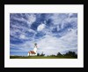 Cape Blanco Lighthouse on the Oregon Coastline with clouds by Corbis