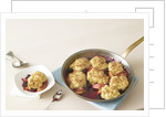 Baked peaches and berries with biscuits by Corbis