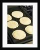 Cooking corn tortillas by Corbis