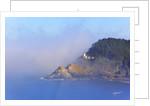 Fog adds beauty to Heceta Head Lighthouse, Oregon Coast, Pacific Ocean by Corbis