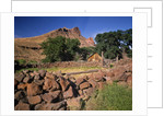 Stone corral fence and barn by Corbis