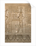 Ancient Egyptian sunken relief depicting the god of Nile, Hapy, and hieroglyphs by Corbis