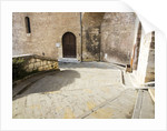 Stairs winding down hill in Old Town of Gubbio by Corbis