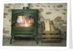 A fire in a green wood buring stove by Corbis