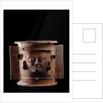 Funeral urn depicting a human face by Corbis