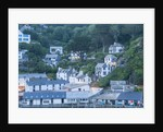 Polperro is a village with beautiful ancient houses along a canal by Corbis