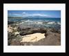 Woman sunbathing in secluded area of sand, Ho'okipa Beach Park, Maui, Hawaii MR by Corbis
