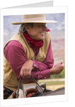 Cowboy on Horse back watching the country by Corbis